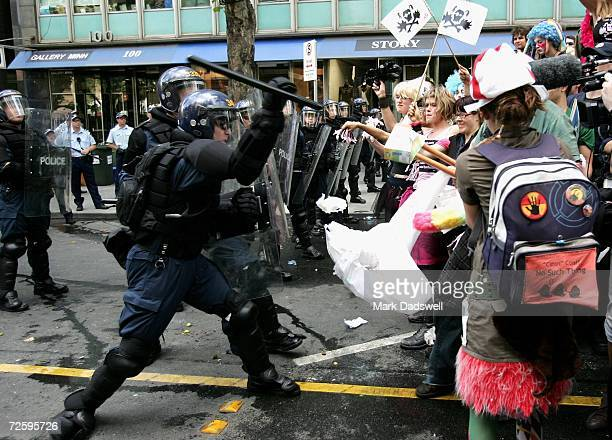Protestors rallying against the G20 meeting attempt to cross police barricades in Collins Street after a protest march to the Grand Hyatt Hotel...