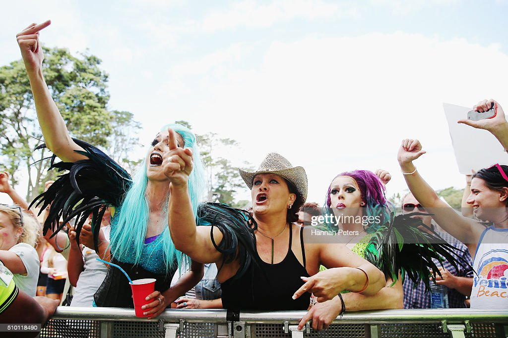 Protestors react as New Zealand Prime Minister John Key speaks at The Big Gay Out on February 14, 2016 in Auckland, New Zealand.