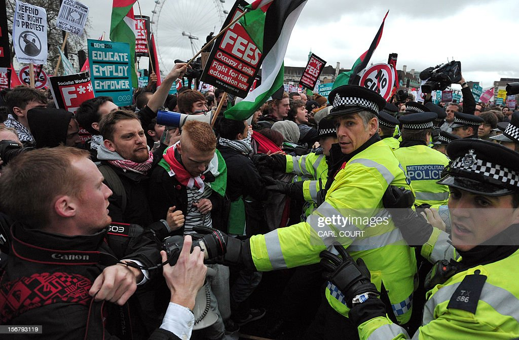 Protestors scuffle with police during a student rally in central London on November 21, 2012 against sharp rises in university tuition fees, funding cuts and high youth unemployment. AFP PHOTO/CARL COURT