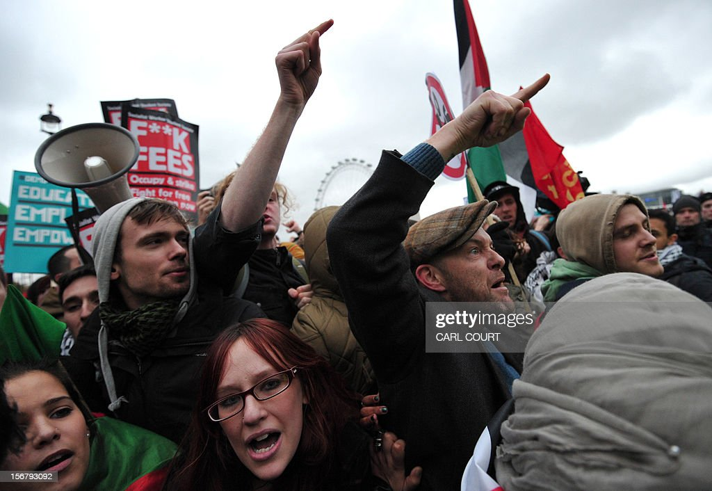 Protestors shout at police during a student rally in central London on November 21, 2012 against sharp rises in university tuition fees, funding cuts and high youth unemployment.