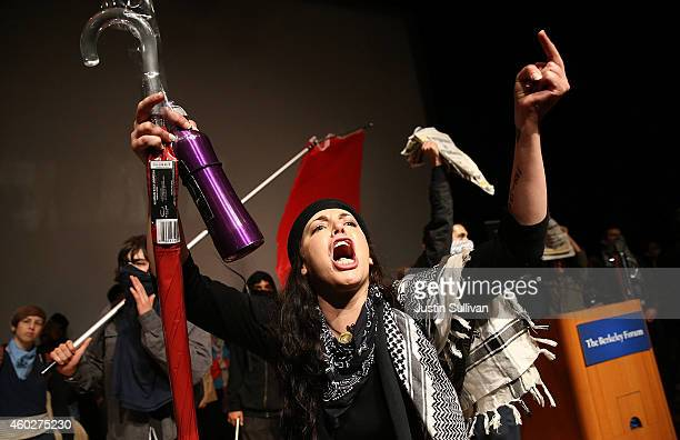 Protestors shout at the audience of a The Berkeley Forum presentation at Wheeler Hall during a demonstration over recent grand jury decisions in...