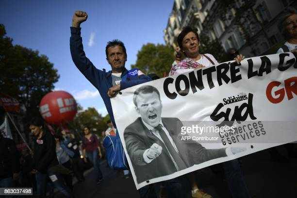 Protestors shout slogans as they march behind a banner during a demonstration called by the General Confederation of Labour French worker's union in...