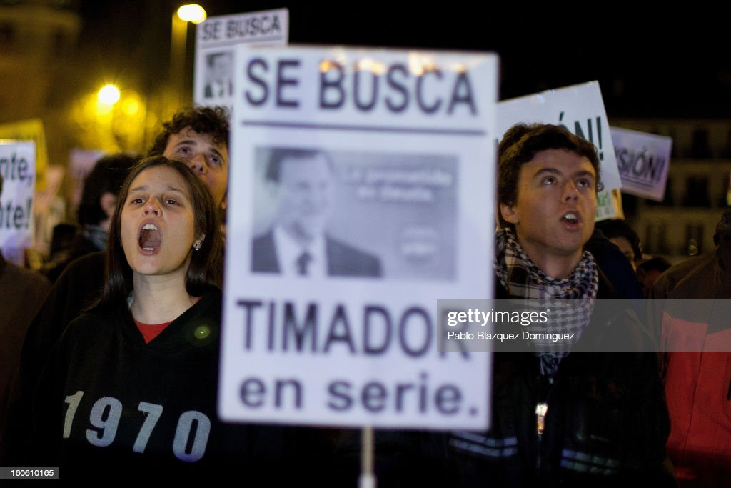 Protestors shout slogans during a demonstration against alleged corruption scandals implicating the PP (Popular Party) in the streets of Madrid on February 3, 2013 in Madrid, Spain. Placard reads 'Wanted. Serial hustler'. Spain's Prime Minister Mariano Rajoy denied yesterday receiving undeclared payments from his political party. More information on secret payments was revealed today and leader of opposition socialist Party (PSOE) urged Rajoy to resign.
