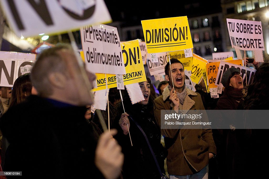 Protestors shout slogans during a demonstration against alleged corruption scandals implicating the PP (Popular Party), on the streets of Madrid on February 3, 2013 in Madrid, Spain. Spain's Prime Minister Mariano Rajoy yesterday denied receiving undeclared payments from his political party. More information on secret payments were revealed today and leader of opposition socialist Party (PSOE) urged Rajoy to resign.