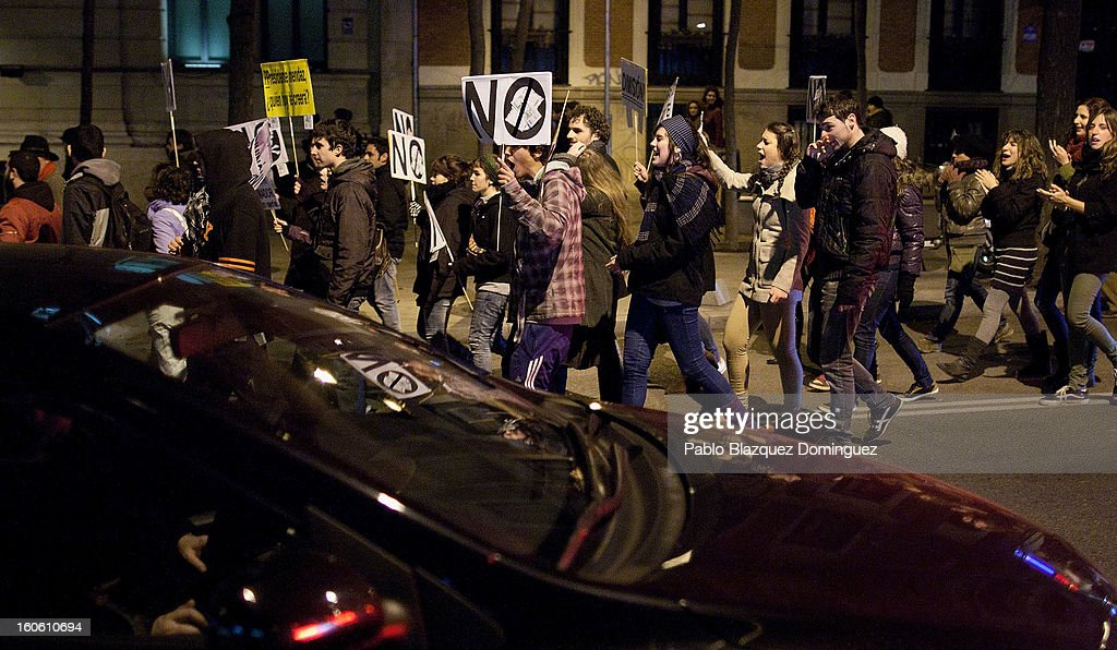 Protestors shout slogans during a demonstration against alleged corruption scandals implicating the PP (Popular Party) in the streets of Madrid on February 3, 2013 in Madrid, Spain. Spain's Prime Minister Mariano Rajoy yesterday denied receiving undeclared payments from his political party. More information on secret payments were revealed today and leader of opposition socialist Party (PSOE) urged Rajoy to resign.