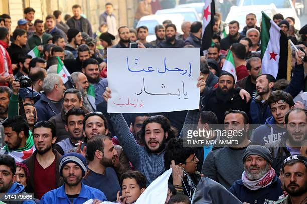 Protestors shout slogans during an antiregime demonstration in the rebelcontrolled side of the Syrian city of Aleppo on March 7 2016 Arabic writting...