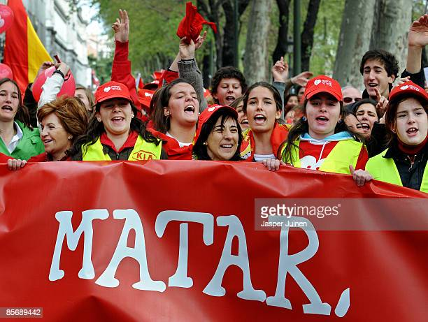 Protestors shout slogans from behind a banner reading 'Kill' during a church backed antiabortion demonstration on March 29 2009 in Madrid Spain A new...