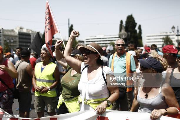 Protestors shout slogans outside the Greek parliament during in a demonstration by municipal contract workers in Athens Greece on Thursday June 29...