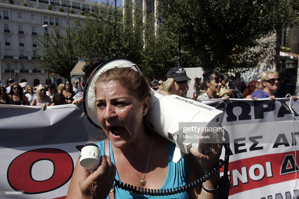 A protestors shouts into a megaphone during a demonstration against austerity and job cuts on September 18, 2013 in Athens, Greece. As part of the redeployment plan in the country reeling from six years of recession, civil servants have to accept new posts or spend eight months on reduced salaries as alternative posts are found, with the risk of losing their jobs altogether.