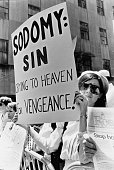 Protestors show their distaste at a Gay Pride parade in New York City USA 19th June 1986