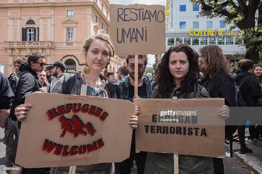 Protestors show their signs during May Day protests on May 01, 2016 in Rome, Italy. Police clashed with protestors as hundreds took to the streets to participate in May Day marches and gatherings across Italy, with many demonstrators demanding a solution to the migrant crisis.