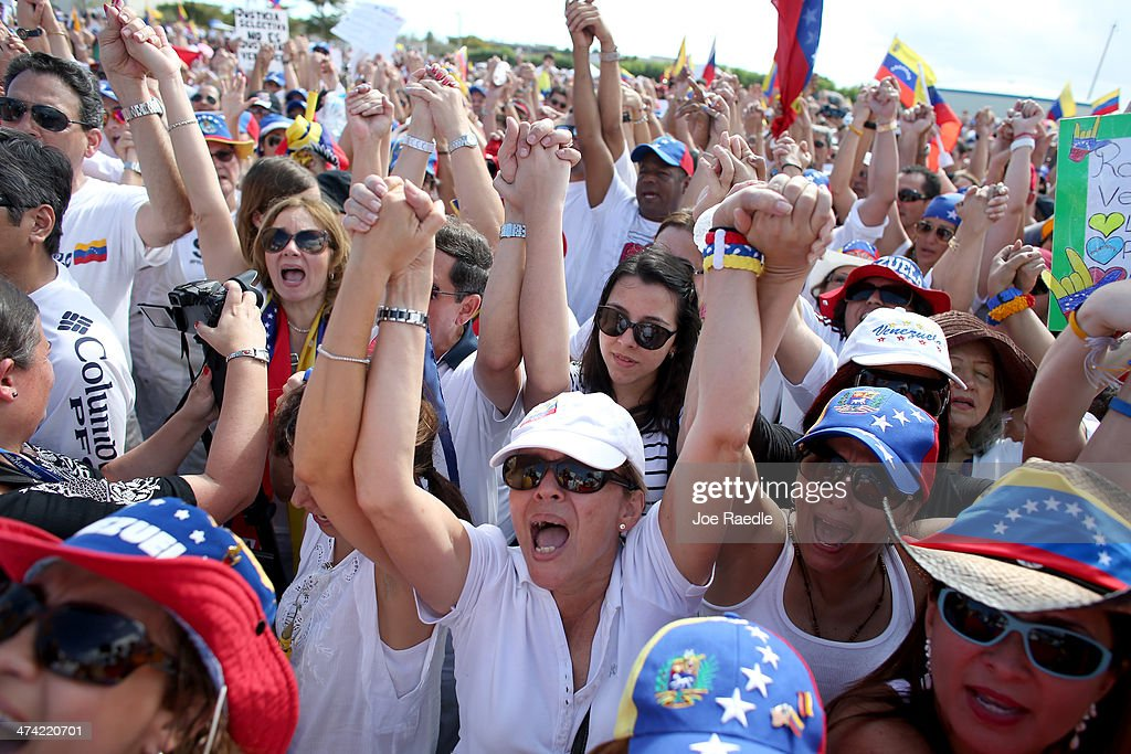 Protestors show their support with the anti-government protests in Venezuela on February 22, 2014 in Doral, Florida. In Venezuela, protests over the past couple of weeks have resulted in violence as government opponents and supporters have faced off in the streets.