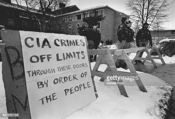 A protestor's sign is hastily tacked onto a makeshift police barricade in front of Willard Hall on the CU Boulder campus where CIA interviewers were...
