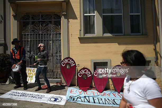 Protestors stage a demonstration outside of an apartment building that allegedly evicted all of the tenants to convert the units to AirBnb rentals on...