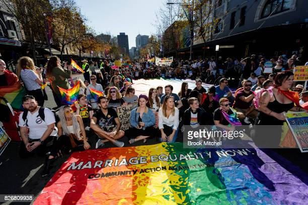 Protestors stage a sit down on Sydney's Oxford Street on August 6 2017 in Sydney Australia The federal government is under increasing pressure to...
