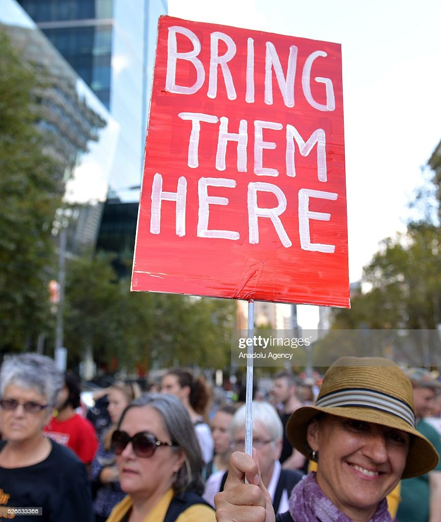 Protestors stage a sit-i protest demanding that asylum seekers held in off shore detention to be brought to Australia at a rally in Melbourne, Australia on April 30, 2016.