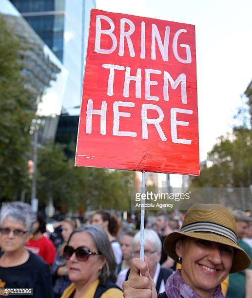 Protestors stage a siti protest demanding that asylum seekers held in off shore detention to be brought to Australia at a rally in Melbourne...