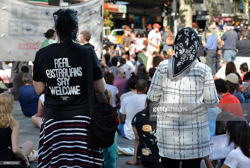 Protestors stage a sit-in protest demanding that asylum seekers held in off shore detention to be brought to Australia at a rally in Melbourne, Australia on April 30, 2016.