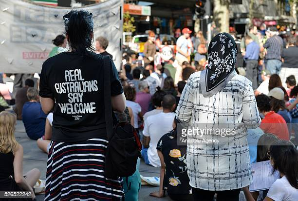 Protestors stage a sitin protest demanding that asylum seekers held in off shore detention to be brought to Australia at a rally in Melbourne...