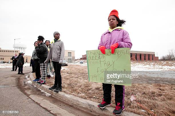 Protestors stand at the Flint Water Plant after participating in a national milelong march to highlight the push for clean water in Flint February 19...