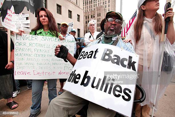 Protestors stand in front of the Federal Courthouse outside the Federal Courthouse to protest the start of the City of Detroit's historic bankruptcy...
