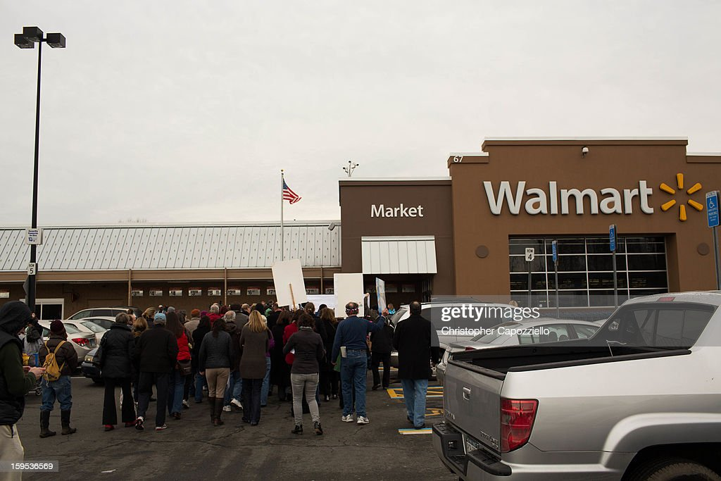 Protestors stand outside the Danbury Walmart January 15, 2013 in Danbury, Connecticut. Gun control advocates along with parents of victims and gun violence survivors joined together to urge Walmart, the nation's largest gun retailer to stop the sale of assault weapons and munitions in their stores nationwide.