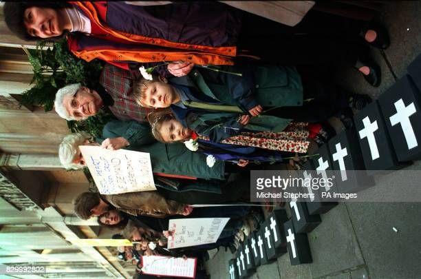 Protestors stand outside the General Medical Council in London with other families and their supporters who are demanding a public inquiry into why...