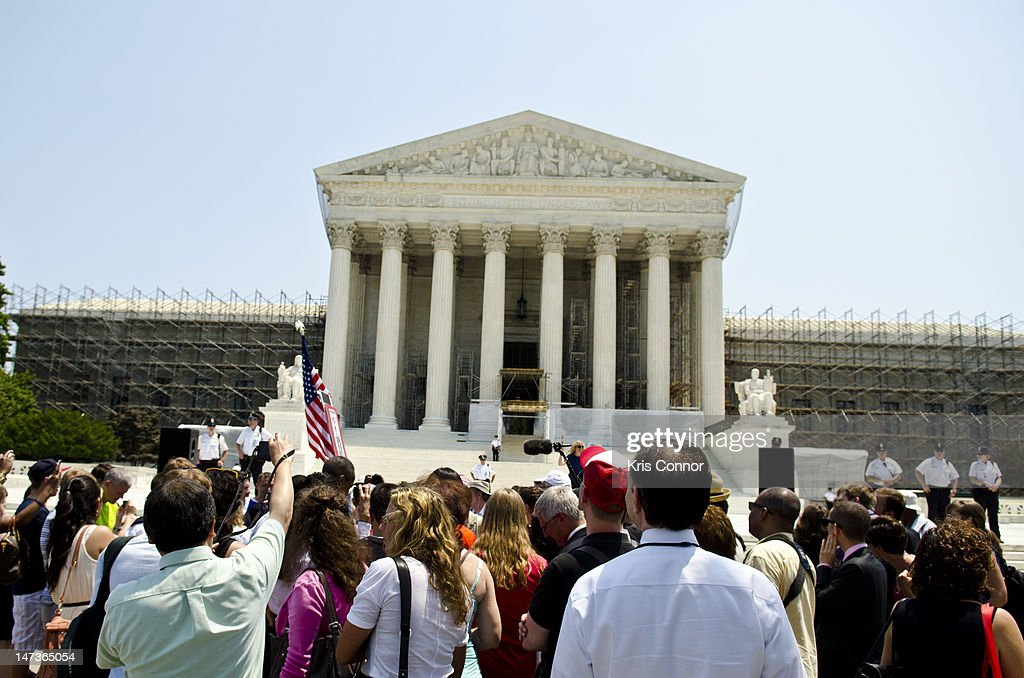 Protestors stand outside the U.S. Supreme Court on June 28, 2012 in Washington, DC. The Court found the Affordable Healthcare Act to be constitutional and did not strike down any part of it.