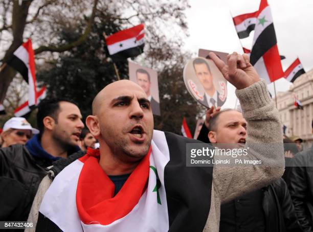 Protestors take part in a demonstration against President of Syria Bashar alAssad outside the Syrian Embassy in central London