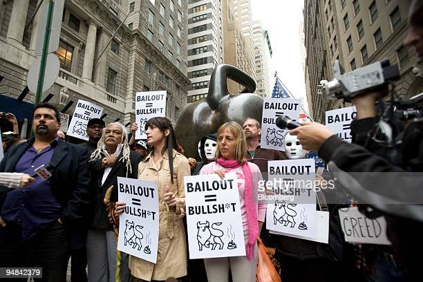 Protestors take part in a demonstration behind of the charging bull statue on Broadway near Wall Street in New York US on Thursday Sept 25 2008 2650...