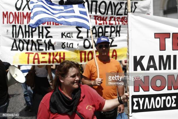 Protestors take part in a demonstration by municipal contract workers in Athens Greece on Thursday June 29 2017 The change in sentiment toward Greece...