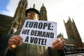 Protestors take part in a demonstration calling for a referendum on the European Union Lisbon Treaty outside the Houses of Parliament in central...