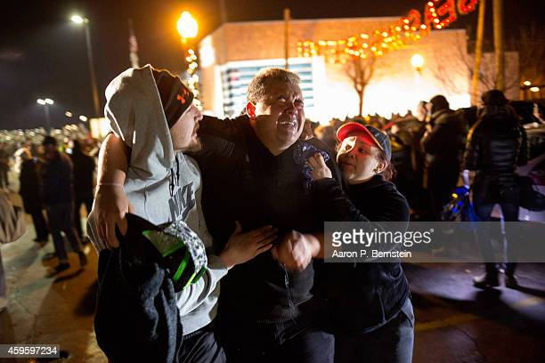 Protestors tend to an activist who was maced as violent demonstrations engulf Ferguson on November 26 2014 in Ferguson Missouri Over 2000 Missouri...
