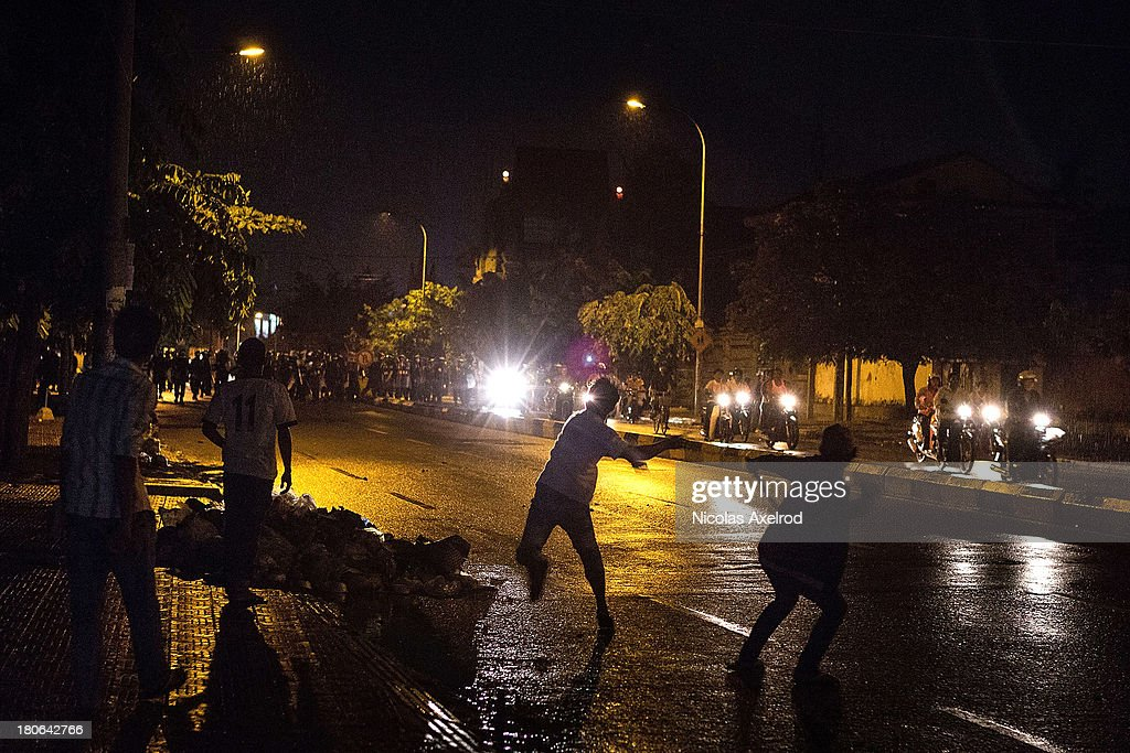 Protestors throw projectiles at anti-riot police after clashes erupted near Monivong bridge South of Phnom Penh on September 15, 2013 in Phnom Penh, Cambodia. The CNRP plan a three day demonstration to contest the Cambodian national election results.