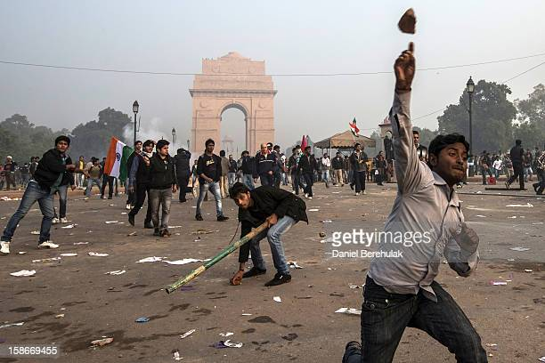 Protestors throw projectiles at Delhi police officers during a protest against the Indian governments reaction to recent rape incidents in India in...