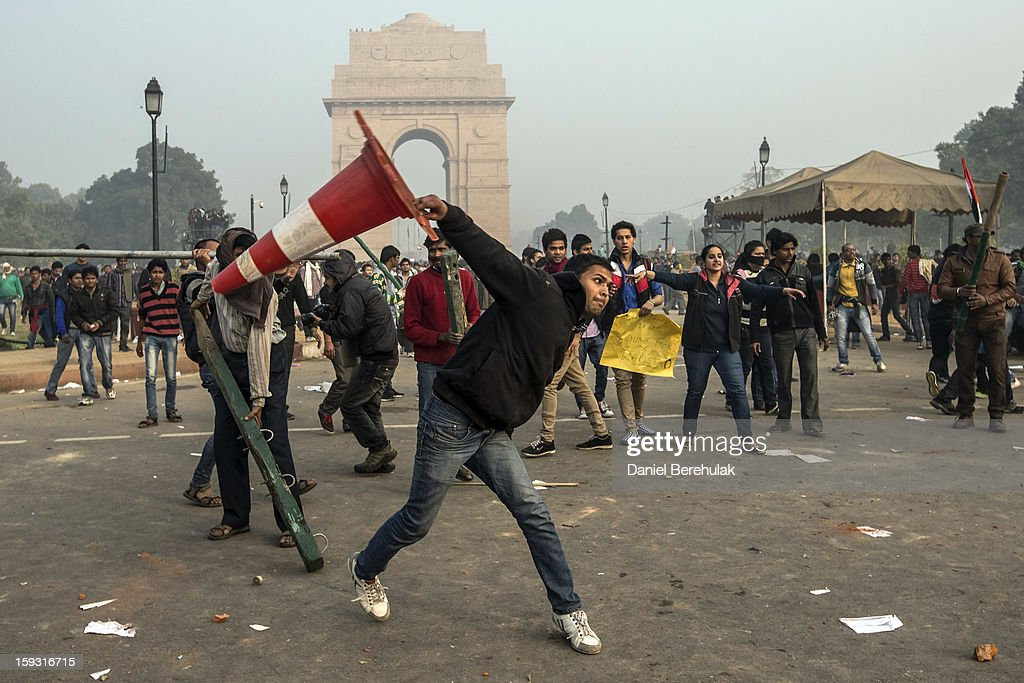 Protestors throw projectiles at Delhi police officers during a protest against the Indian governments reaction to recent rape incidents in India, in front of India Gate on December 23, 2012 in New Delhi, India. The gang rape of a 23-year-old paramedical student in a moving bus on December 16, in Delhi, has led to people to react openly against the governments current rape laws. Over a thousand protesters gathered in front of Delhi to protest against lax laws and the governments handling of recent rape cases all over India.