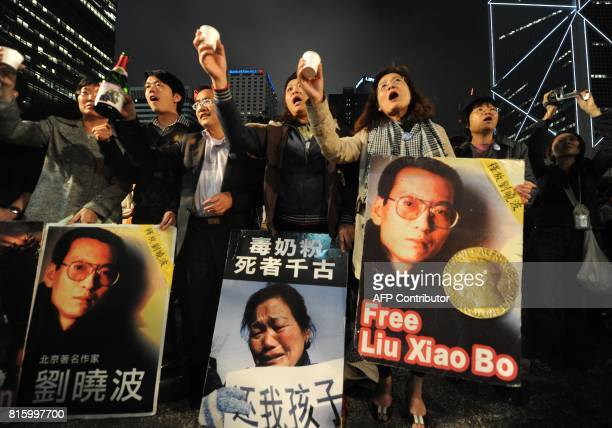 Protestors toast Nobel prize winner Liu Xiaobo in Hong Kong on December 10 2009 China clamped down on dissidents the Internet and the media as the...