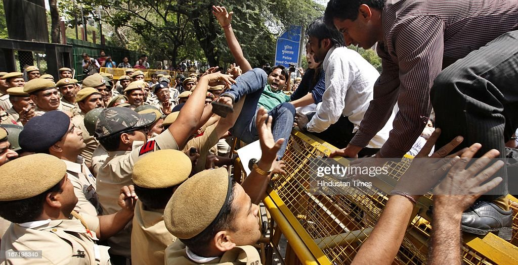 Protestors trying to bring down a barricade during a protest against the rape of a five year old girl and alleged police insensitivity in such cases at Delhi Police Headquarters on April 22, 2013 in New Delhi, India. The protesters are demanding the resignation of Delhi Police Commissioner Neeraj Kumar for his failure to prevent crime against women. As many as 463 rape cases have been registered in Delhi in the first four and a half months of 2013, indicating an increase of 158 percent over the same period last year.