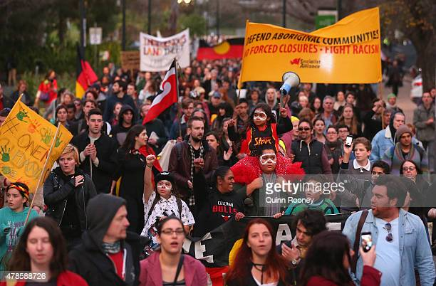 Protestors walk the streets of Melbourne on June 26 2015 in Melbourne Australia Thousands of protesters gathered in Melbourne today to rally against...