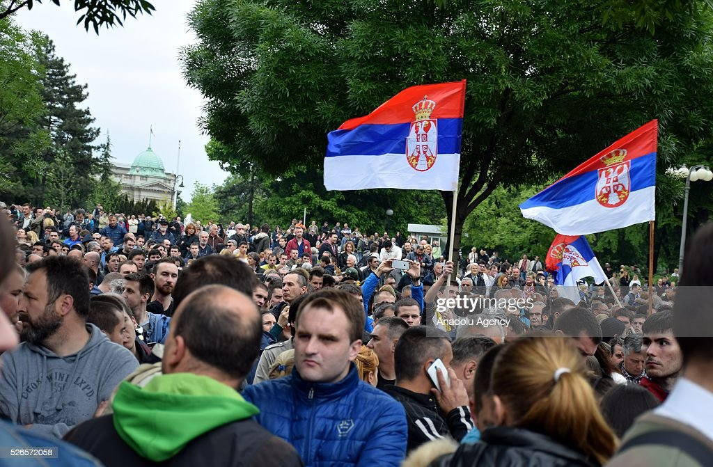Protestors wave Serbian flags in front of the Electoral Commission during a protest organised by Serbian main opposition parties against alleged electoral 'fraud' at last weekend polls in downtown Belgrade, Serbia on April 30, 2016.