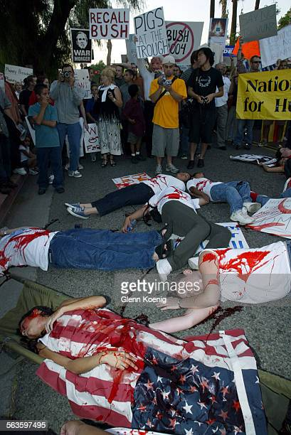Protestors wearing fake blood perform a'Die In' to simulate death from war as bout 300 people demonstrated during the visit of the President to the...