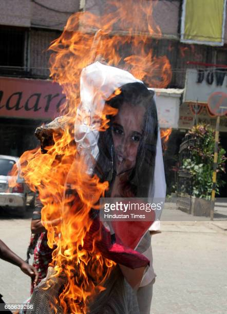 Protests and Demonstration Sania Mirza and Shoaib Malik Wedding Member of Lokadhikar Welfare Trust burn effigy of Sania Mirza to protest her decision...