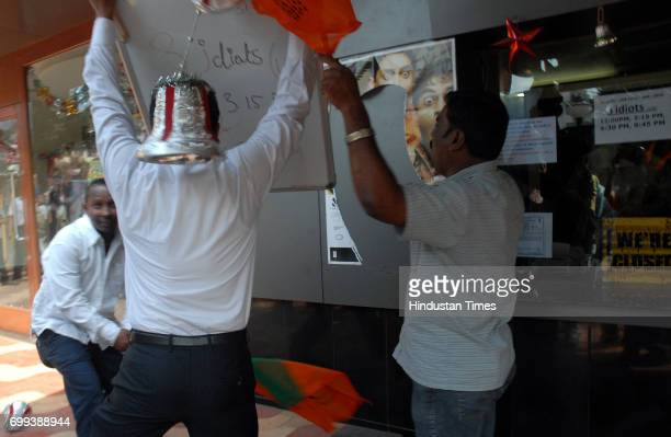 Protests and Demonstrations BJP supporters and party workers tear off the posters of the film 3 Idiots after the suicide of a 12yearold at Dadar...