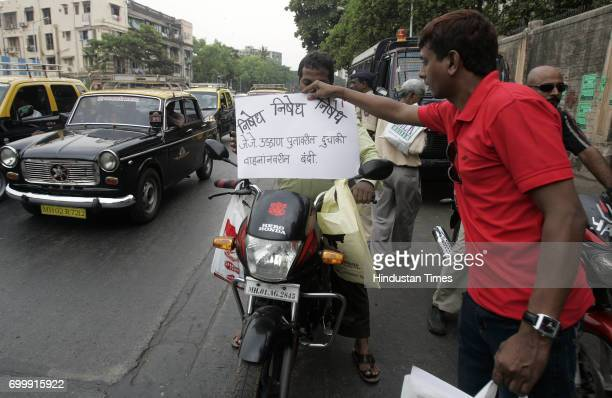 Protests and Demonstrations Citizens across the city protested against the traffic police initiative to ban two wheelers over the JJ flyover by...