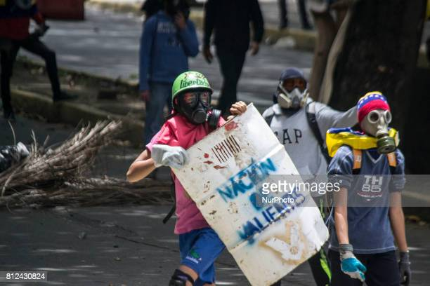 Protests in Caracas on July 10 2017 Venezuela hit its 100th day of antigovernment protests Sunday amid uncertainty over whether the release from...