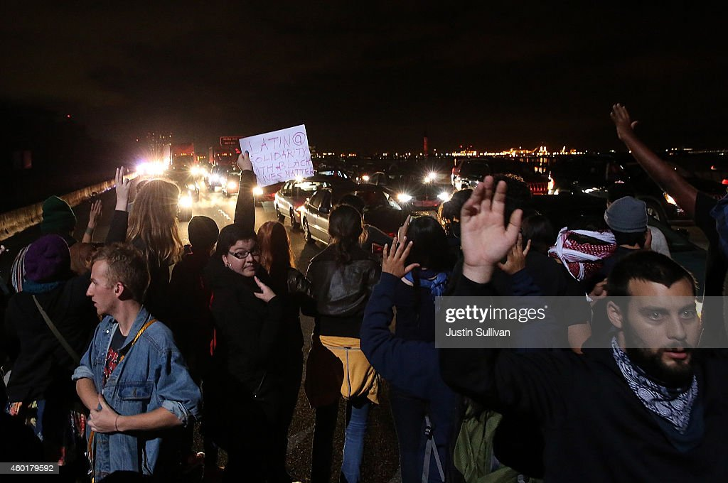 Proteters block interstate 80 during a demonstration over recent grand jury decisions in policeinvolved deaths on December 8 2014 in Berkeley...