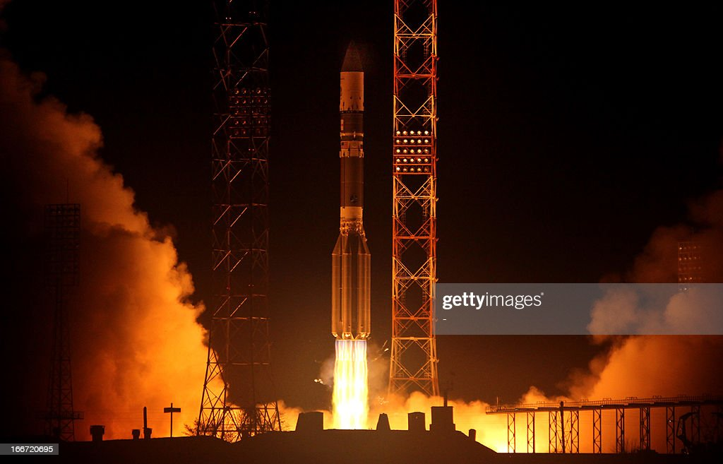 A Proton-M rocket, carrying Canada's Anik G1 telecommunications satellite satellite, blasts off from the Russian leased Kazakhstan's Baikonur cosmodrome early on April 16, 2013.