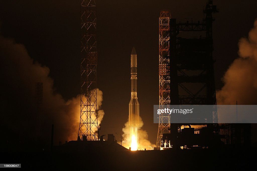 A Proton-M rocket, carrying the Yamal-402 communications satellite, blasts off alaunch pad at the Russian leased Kazakhstan's Baikonur cosmodrome on December 8, 2012. The Russian carrier rocket successfully placed on the target orbit the communications satellite, the Russian media reported .