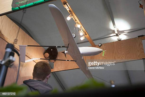 A prototype drone or unmanned aerial vehicle hangs on opening day of the World Ag Expo on February 10 2015 in Tulare California Even as California...
