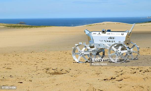 A prototype model of a lightweight moon rover developed by Japan's Team HAKUTO makes a test run on Tottori Sand Dunes in Tottori along the Sea of...